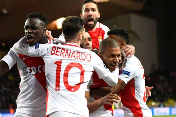 AS Monaco players celebrate their victory over BVB